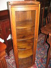 Tall oak bowfront display cabinet