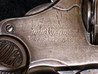 close up- engraving of Madden's pistol