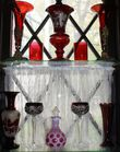 Group of red glass incl vases