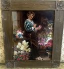 Portrait of woman in carved frame