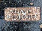 Iron Rail Road Sign