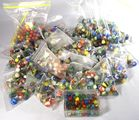 Lot 81) 36 bags early assorted marbles