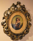Oval painting in gold frame