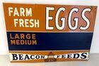 Lot# 1 - Beacon Feeds Egg Sign Tin